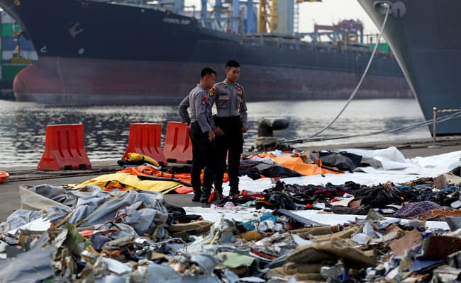 Black box from crashed Indonesian jet retrieved, diver says