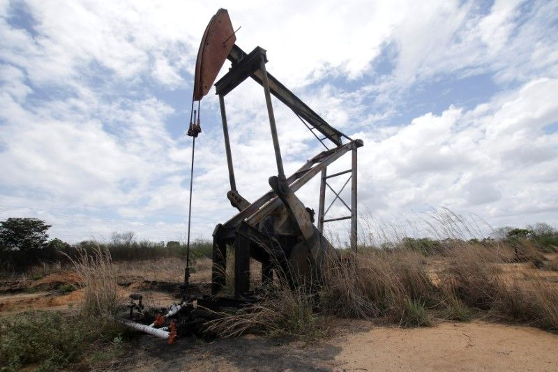 Oil prices climb on OPEC-led cuts, but off session highs