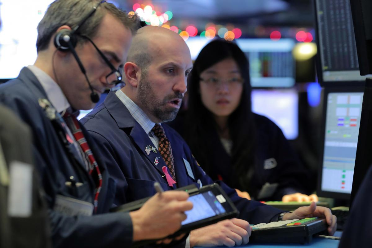 Global shares mixed as trade worries loom; oil surges
