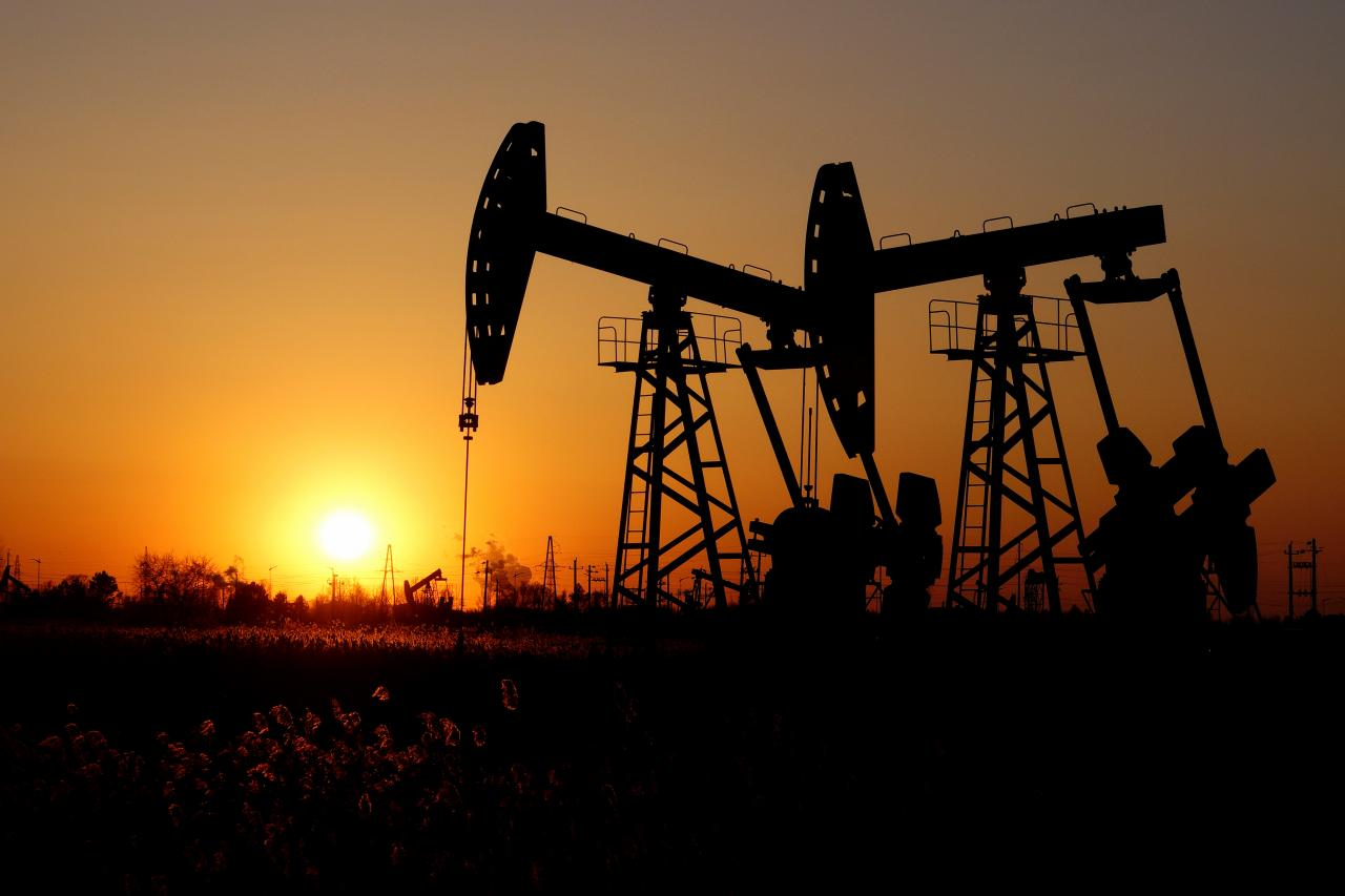 Oil prices dip on signs of economic slowdown, but OPEC-led cuts provide support