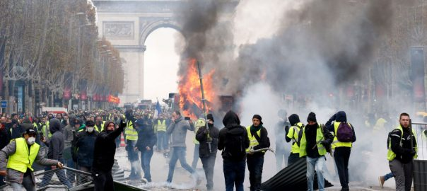 yellow protest paris fuel hike Emmanuel Macron' economic reforms