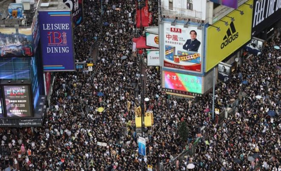 Hong Kong protests resume as masses march amid high security