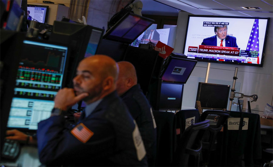 Global stocks, dollar rise on hopes of easing US-China trade tensions
