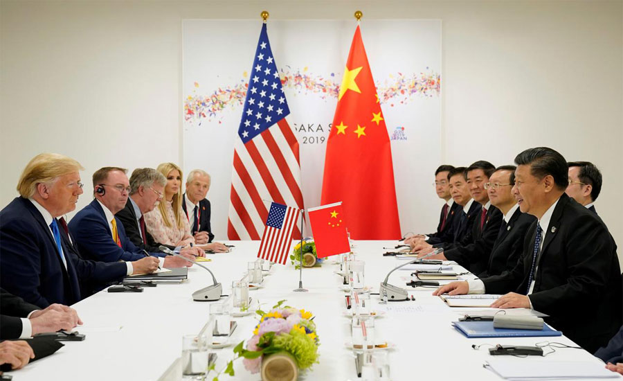 Trump defends stance on China trade after new tariffs