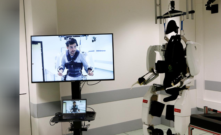 Paralyzed man hails 'feat' walking again robot exoskeleton
