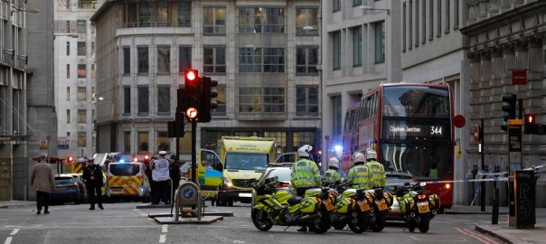 British police ,shot dead ,man ,suicide vest ,stabbed ,London ,wounded ,authorities