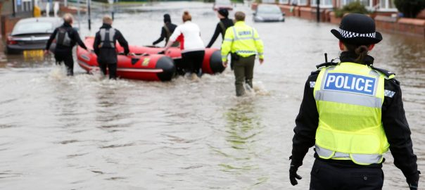 Woman, dies, downpours, floods, central, northern, England