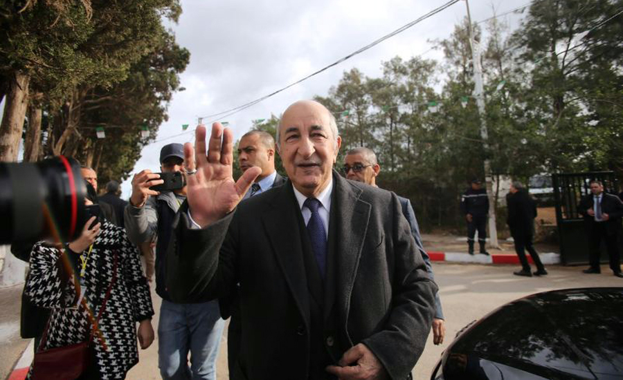 Ex-premier, elected, Algerian president, thousands, prepare, march