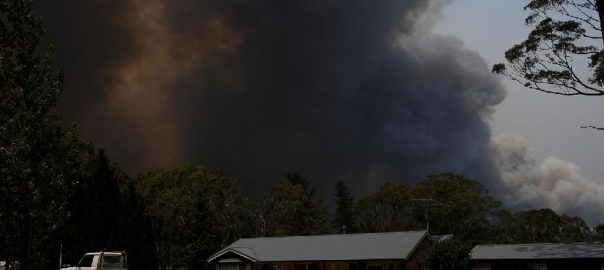 Australian, firefighters, access, badly burned towns; PM, defends, climate, policies