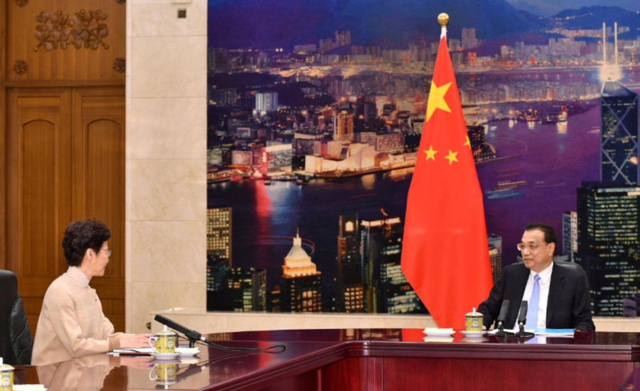 Xi vows support for Hong Kong leader during most difficult time