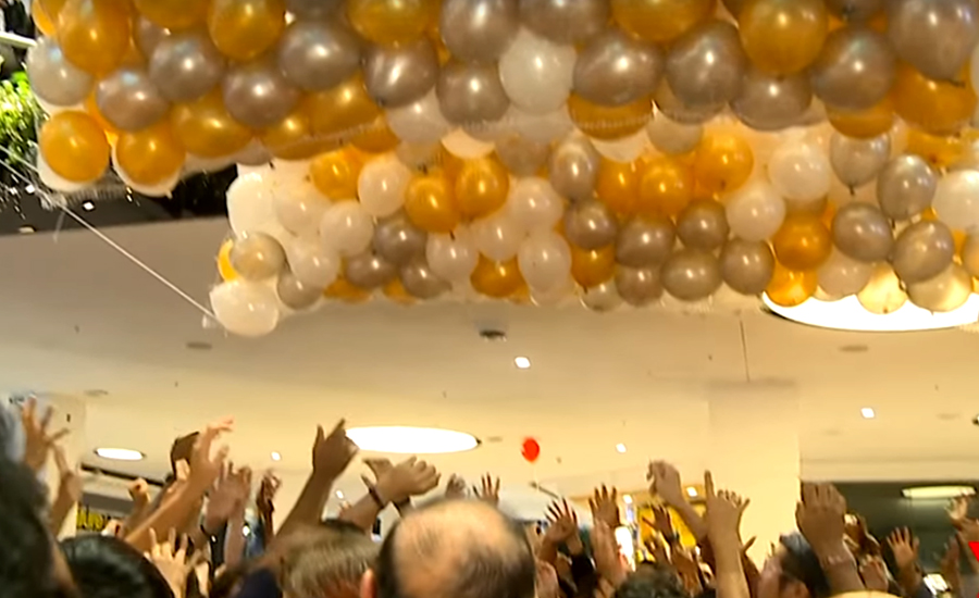Five in hospital after balloon drop sparks stampede at Australian shopping centre
