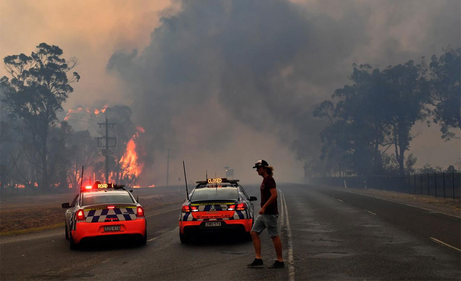 Australian leader curtails holiday as firefighters killed in huge blazes