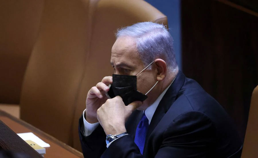 Netanyahu, fighting for political life, lashes out at deal to unseat him