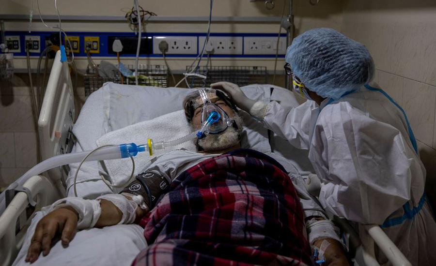 India reports 100,636 new COVID-19 infections, 2,427 deaths