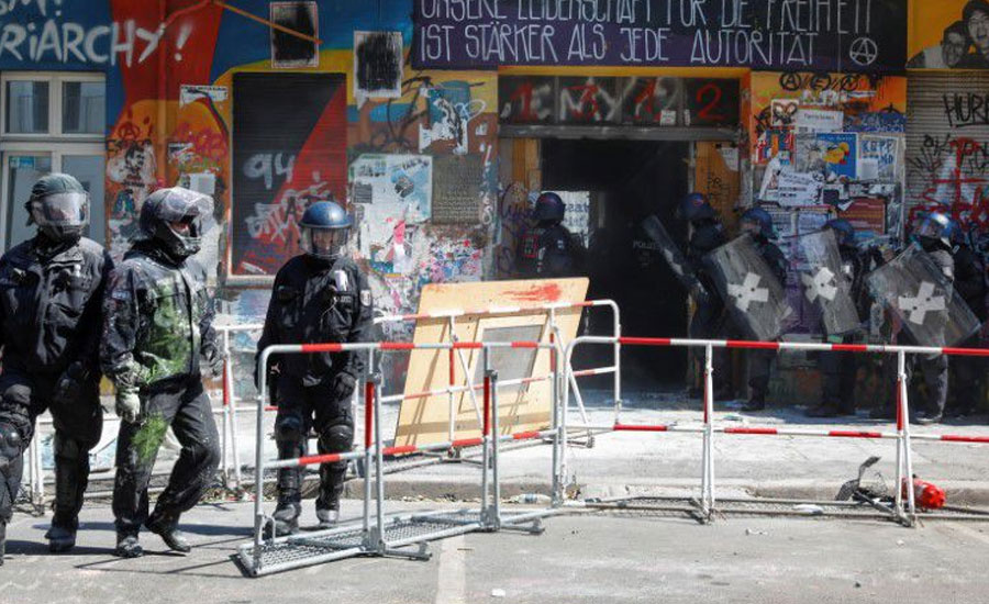 Berlin police force entry to long-time squat under hail of fireworks, smoke bombs